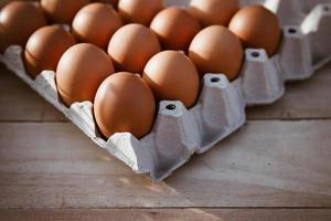 Eggs in paper boxes placed on wooden floors photo