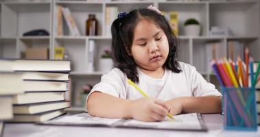 Little Girl Enjoys Coloring on Drawing Paper video