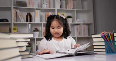 Little Girl Happily Sitting and Reading a Picture Book video