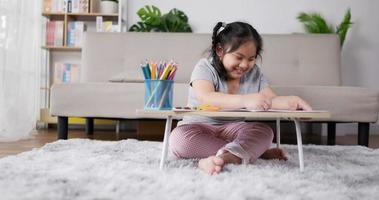 Little Girl Enjoys Drawing Paper in Living Room video