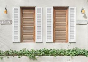Old window pattern on wall photo