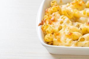 American mac and cheese, macaroni pasta in cheesy sauce photo