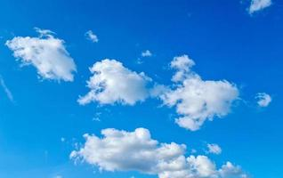 Blue sky background with clouds photo
