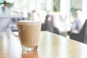 Hot latte coffee cup in coffee shop photo
