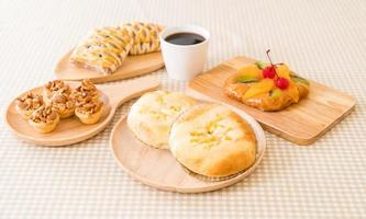 Bread with corn and mayonnaise on the table photo