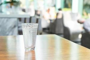 Glass of water on the table photo