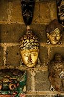Traditional masks on a wall, Bali, Indonesia photo