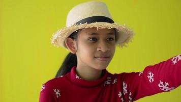 Girl in red sweater wears straw hat showing an angry expression. video