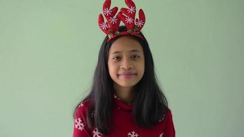 Pretty girl in red sweater holding gift box and gives it by hands. video