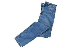 Men women jeans isolated. Folded trendy blue jeans trousers isolated photo