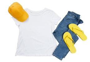 White t-shirt mockup isolated, yellow cap, blue denimand flip flops photo
