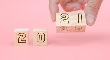 Number 2021 and 2022 on wooden block for new year.  Start new year photo