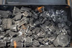 Coals are burned in a BBQ grill photo
