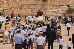 Jerusalem, Israel - May 9, 2016 - Jewish worshipers gather for a Bar Mitzvah ritual photo