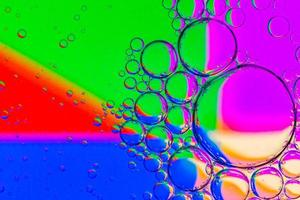 Abstract Background of Oil Bubbles on Water Surface colorful palette photo