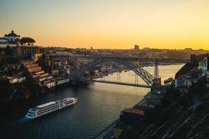 Dom Luiz bridge over River Douro in Porto in Portugal at dusk photo