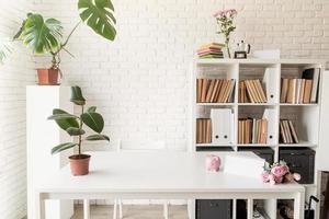 stylish room interior, bookshelves and workspace photo