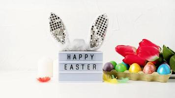Happy Easter light box with rabbit ears and Easter decorations photo