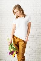 woman wearing blank white t-shirt holding tulips flowers photo