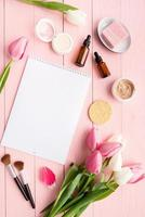 pink and white tulips with calendar or notepad for mock up flat lay photo