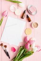 pink and white tulips with greeting card for mock up top view flat lay photo
