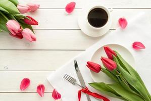 Elegant festive table setting with floral decor photo