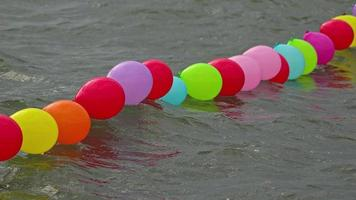 Colorful Child Balloons Floating On The Water Surface video