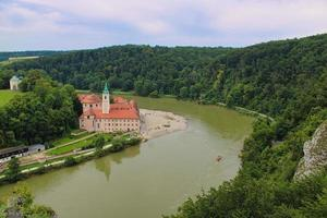 Kloster Weltenburg monastery at the riverbank of Danube River photo