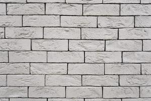 grey decorative brick wall with aged texture isolated closeup photo
