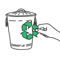 hand holding recycle sign on trash bin vector