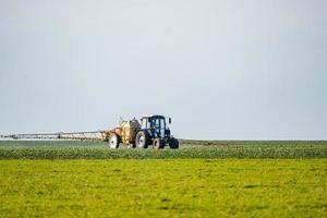 Tractor watering the field photo