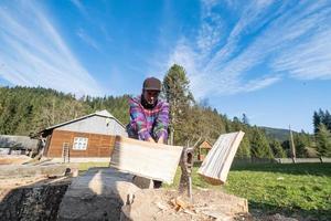 Lumberjack on the farm photo