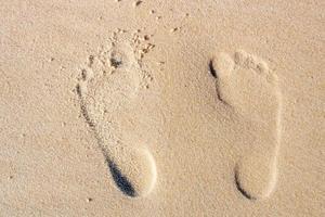 Footprint in the sand at Copacabana beach, Rio de Janeiro, Brazil photo