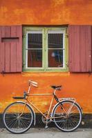 Windows with orange wall and vintage bicycle photo