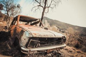 Old rusty and destroyed car photo