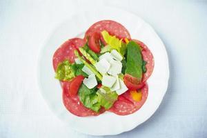 Antipasto salad with cheese and salami photo