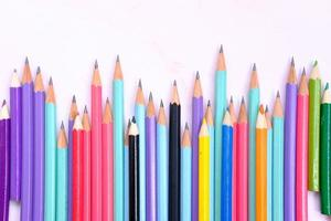 Pen and pencil, office equipment on table background photo