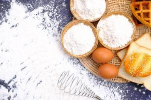Flour and eggs for baking ingredients photo