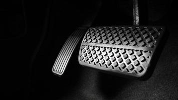 Man foot and accelerator and brake pedal inside the car photo