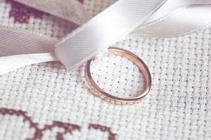 Wedding ring with white ribbon photo