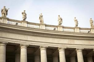 Marble sculptures of the popes on St. Peters Square in Vatican City photo
