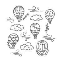 globo de aire caliente y nubes. vector dibujado a mano ilustración de doodle