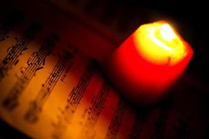 Music Notes Sheet in a Red Candle Light photo