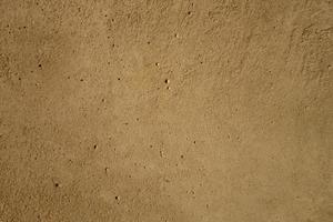 The surface of a concrete construction slab with a many little holes photo