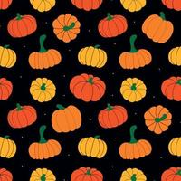 vector pattern of ripe pumpkins and dots on a black background
