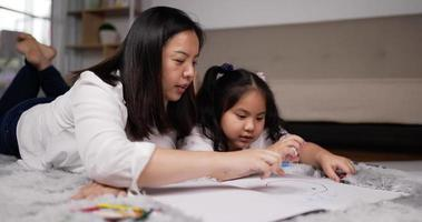 Young Mother and Little Daughter Creating a Drawing video