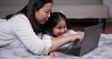 Mother and Daughter Playing Game on Laptop Computer video