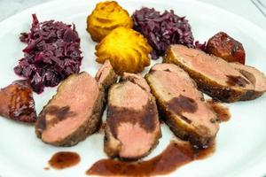 Fried duck breast with red  cabbage and croquettes photo