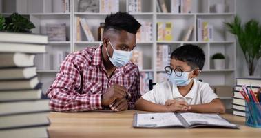 Young Man Teaching a Boy During Quarantine at Home video