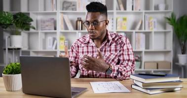 Young Man Has Meeting with Client by Laptop video
